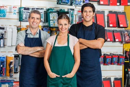 Salespeople Standing In Hardware Store photo