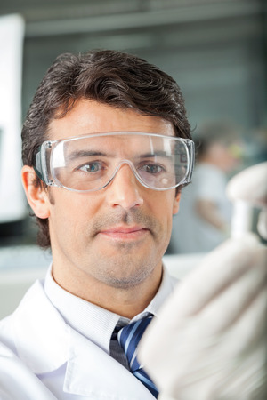 protective spectacles: Scientist In Protective Eyewear At Laboratory