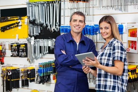 Customer And Vendor With Digital Tablet In Hardware Store