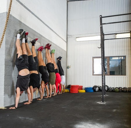 People Doing Handstands At Cross Training Box Stock Photo