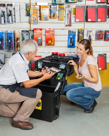 couching: Customer Selecting Tools While Salesman Assisting Her In Store