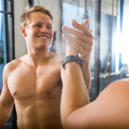 shirtless guy: Happy Athlete Giving High-Five To Friend