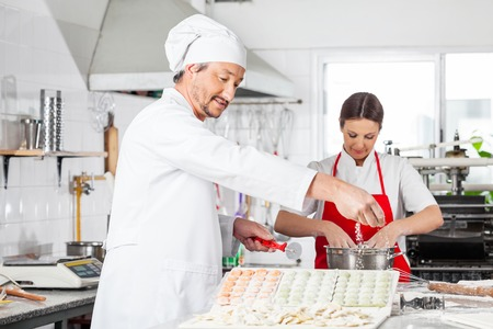 toque blanche: Chefs Preparing Ravioli Pasta
