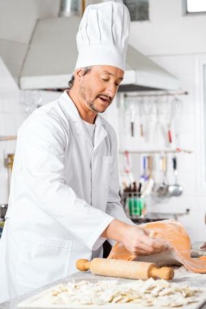 toque blanche: Chef Preparing Ravioli Pasta In Kitchen