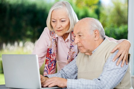 surfing the internet: Serious Senior Man And Woman Using Laptop