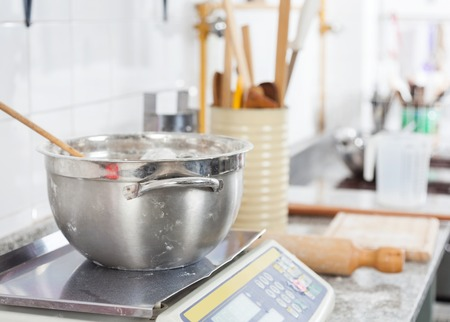 commercial kitchen: Mixing bowl on weight scale at counter in commercial kitchen