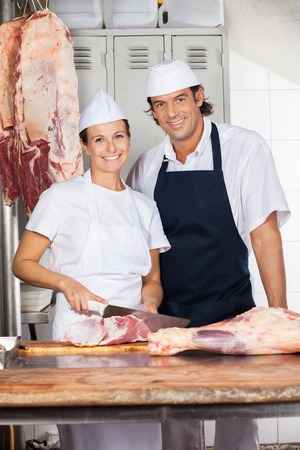 woman knife: Confident Butchers At Counter In Shop