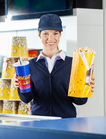 Happy Worker Holding Drink At Cinema Concession Stand Stock Photo ...