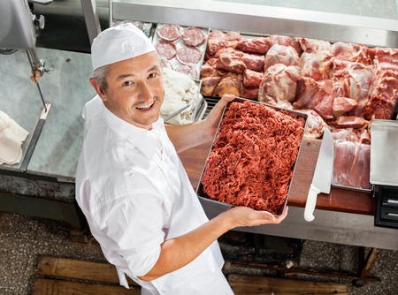 Confident Butcher Holding Minced Meat