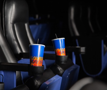 armrest: Cold Drinks In Armrests Of Seats At Theater