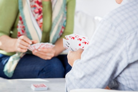 eldercare: Senior Couple Playing Cards