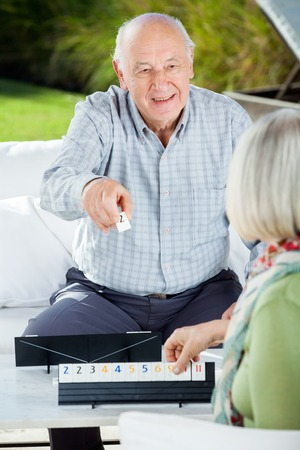 rummy: Happy Senior Man Playing Rummy With Woman Stock Photo