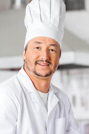 toque blanche: Portrait Of Happy Male Chef Stock Photo