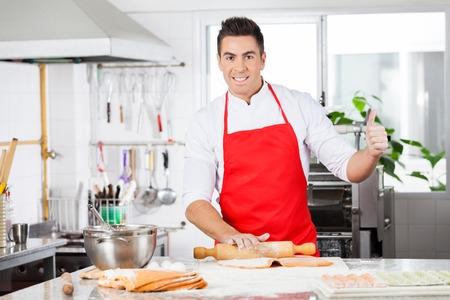 sh: Confident Chef Gesturing Thumbsup While Rolling Ravioli Pasta Sh