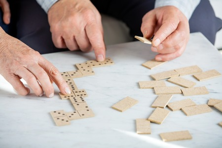 nursing care: Senior Couple Playing Dominoes At Table