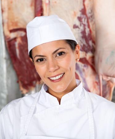 Confident Female Butcher Smiling In Butchery photo