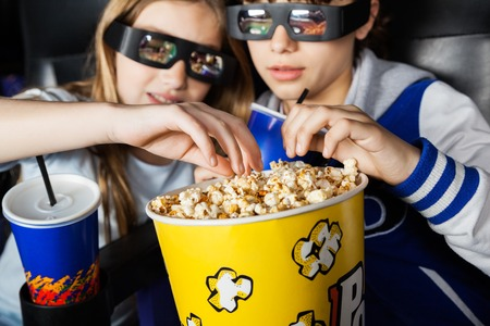 3d: Sisters Having Popcorn In 3D Theater Stock Photo