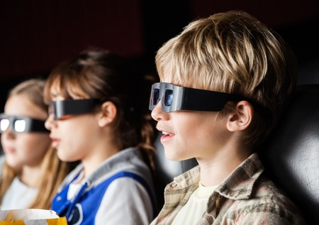 3d: Boy Watching 3D Movie With Siblings