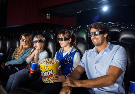 3d: Happy Family Watching 3D Movie In Theater