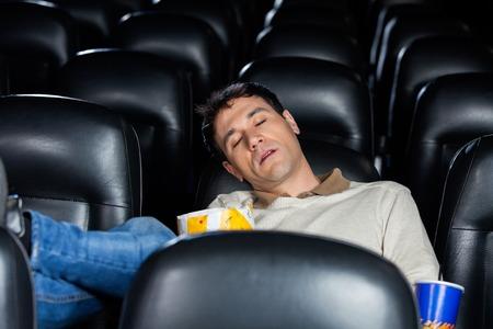 bored man: Bored Man Sleeping At Theater