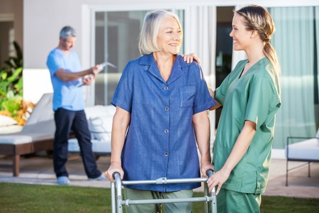 home nursing: Smiling Disabled Woman And Nurse Looking At Each Other