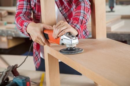 carpenter tools: Carpenter Using Sander On Wood Stock Photo