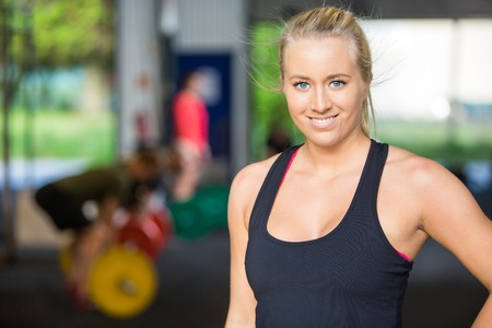 Portrait Of Confident Fit Woman at Cross-Fitness Gym Stock Photo