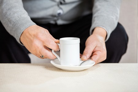 midsection: Midsection Of Senior Man Holding Coffee Cup
