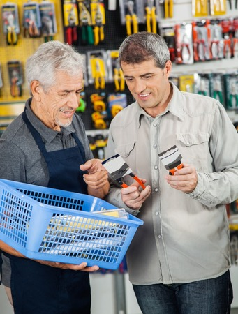 salesperson: Salesperson Assisting Customer In Buying Pliers