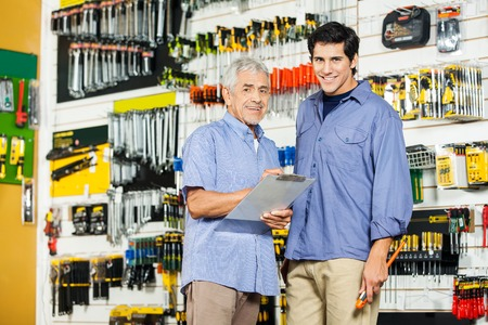 hardware: Father And Son With Clipboard In Hardware Store