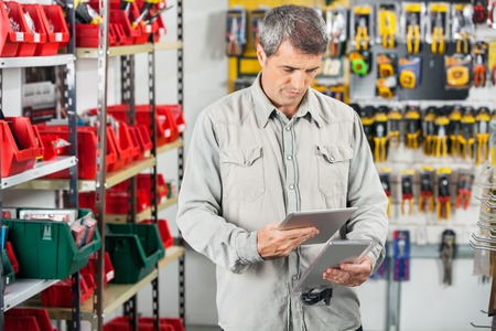 retailer: Customer Analyzing Product Through Digital Tablet