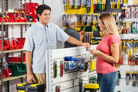 hardware: Couple Choosing Tools In Hardware Store