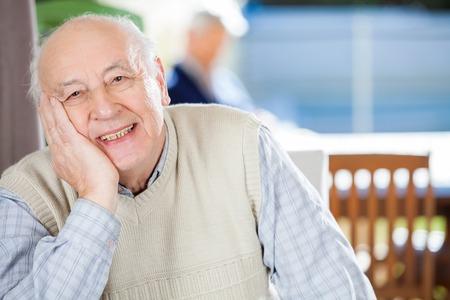 Portrait Of Smiling Senior Man At Nursing Home Reklamní fotografie