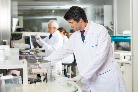 research facilities: Technician Experimenting In Laboratory