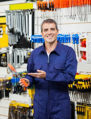 packed: Confident Worker Showing Packed Screwdriver Stock Photo