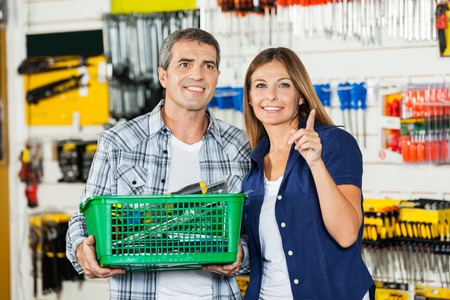Woman Showing Something To Man In Hardware Store photo