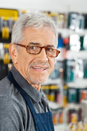 retailer: Salesman Smiling In Hardware Store Stock Photo