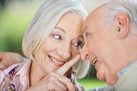 touching noses: Loving Senior Woman Touching Mans Nose