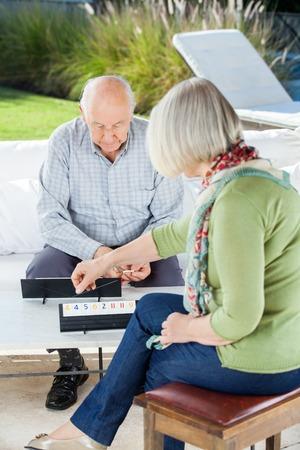 rummy: Senior Man Playing Rummy With Woman