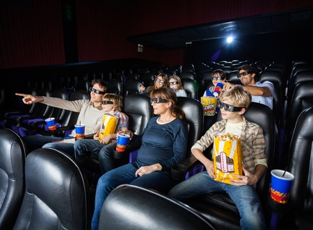 3d: Families Having Snacks In 3D Movie Theater