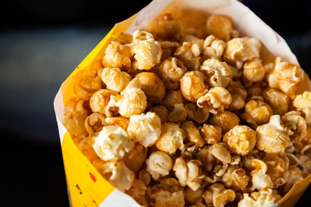paperbag: Roasted Popcorns In Paperbag At Cinema Theater Stock Photo