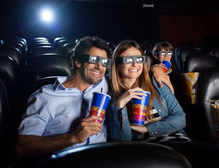 3d: Happy Couple Watching 3D Movie In Theater