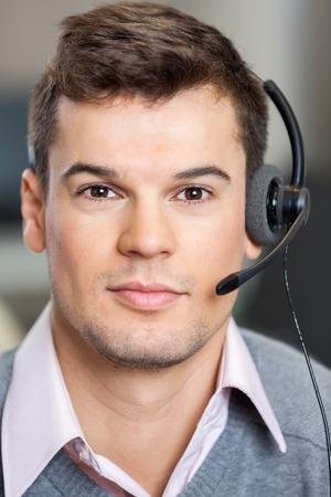 customer service representative: Confident Customer Service Representative Wearing Headset