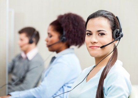 customer service representative: Portrait At Confident Female Customer Service Representative