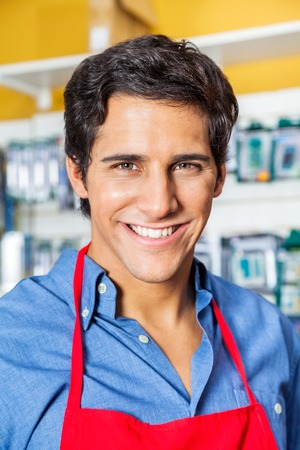 retailer: Confident Male Worker Smiling In Hardware Shop Stock Photo
