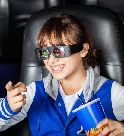 3d: Happy Girl Watching 3D Movie In Theater