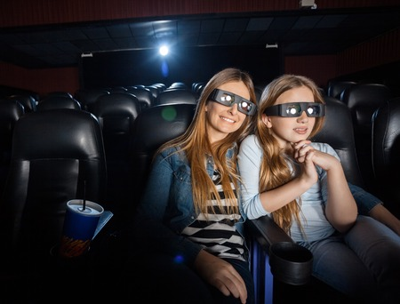 3d: Mother And Daughter Watching 3D Movie In Theater