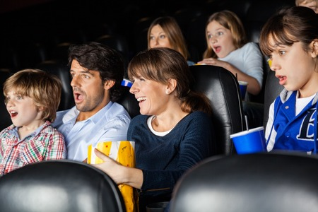 Amazed Families Watching Movie