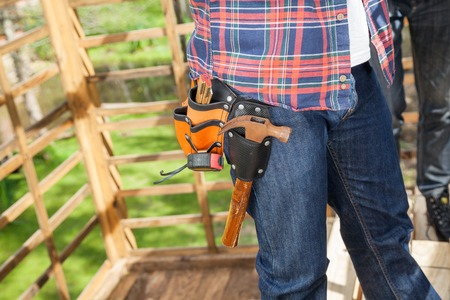 toolbelt: Worker Wearing Toolbelt At Site Stock Photo