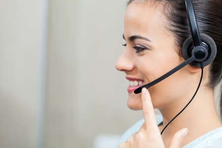 customer service representative: Customer Service Representative Using Headset Stock Photo